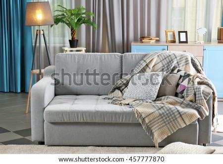Interior with gray sofa - stock photo