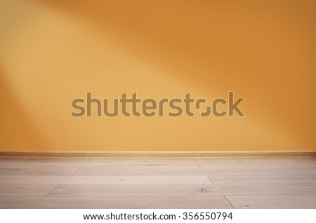 Interior with orange wall and wooden floor - stock photo