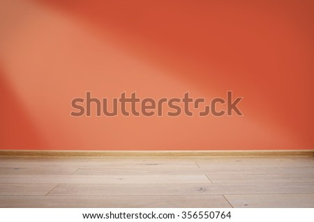 Interior with red wall and wooden floor - stock photo