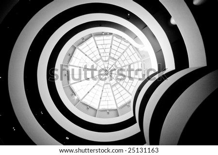 Interior with spirals and glass roof - stock photo
