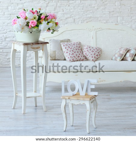 Interior with vintage furniture elements, love letters and decorative flowers - stock photo