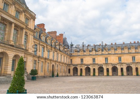 Interior yard the Castle Fontainebleau, one of the largest French royal castles - stock photo