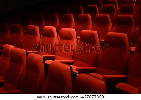 Interiors empty red cinema chairs, red seats. Low-key