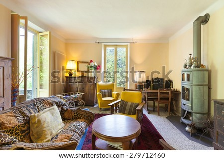 Interiors, nice living room of a rustic home, vintage furniture - stock photo