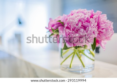 Interiors of a office medical reception with beautiful pink flowers in vase - stock photo