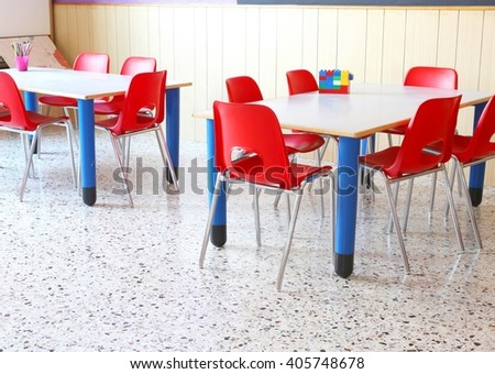 interiot classroom of a kindergarten with red chairs