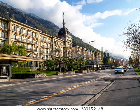 INTERLAKEN APR 13: Five star hotel in Interlaken, Switzerland on April 13, 2011. Interlaken is well-known as the main transport gateway to the mountains and lakes of central Switzerland. - stock photo