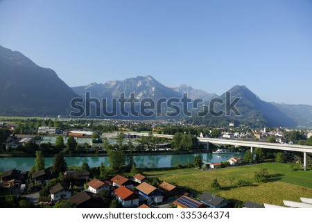INTERLAKEN, SWITZERLAND - JULY 24:  The Interlaken city a tourist destination surrounded by Swiss Alps during morning hours on July 24, 2015, Interlaken, Switzerland - stock photo