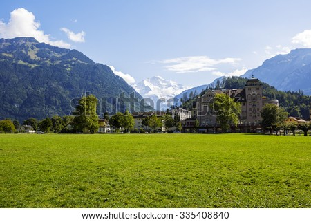 INTERLAKEN, SWITZERLAND - SEPTEMBER 07, 2015: Hohe Matte meadow in the middle of city. It provides perfect location to enjoy an open view of the Jungfrau. Its known as an landing area for paragliders - stock photo