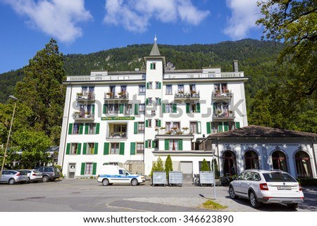 INTERLAKEN, SWITZERLAND - SEPTEMBER 07, 2015: Hotel Interlaken dates back to the 14th century. In 1491 the house was restored and got his own coat of arms, after recent restoration offers 61 rooms  - stock photo