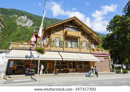 INTERLAKEN, SWITZERLAND - SEPTEMBER 07, 2015: Picturesque Chalet Diana at Hoeheweg Alley. The ground floor store (Zryd) offers a varied assortment of gifts and souvenirs from Switzerland - stock photo