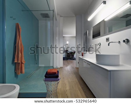 internal view of a modern bathroom with two countertop weshbasin with shower cubicle and wooden floor