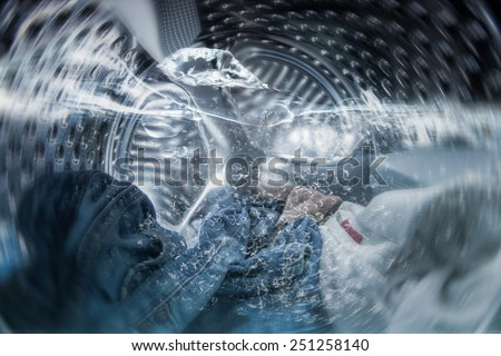 Internal view of a washing machine drum during wash - stock photo