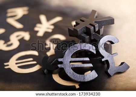 International black currency units on dappled background - stock photo