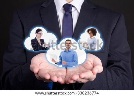 international business and internet concept - clouds with business people in male hands - stock photo