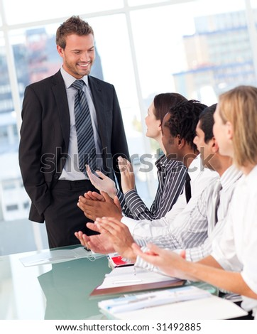 International business people clapping after a presentation