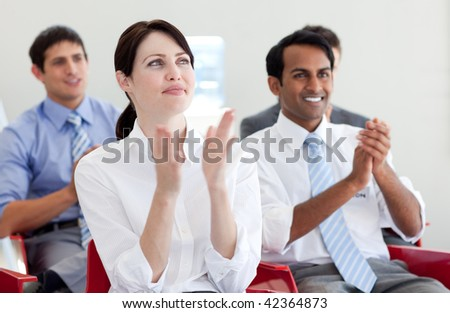 International business people clapping at a conference. Business concept. - stock photo