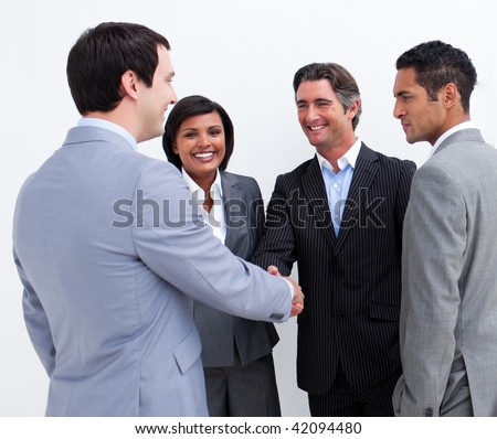 International business people closing a deal in the office