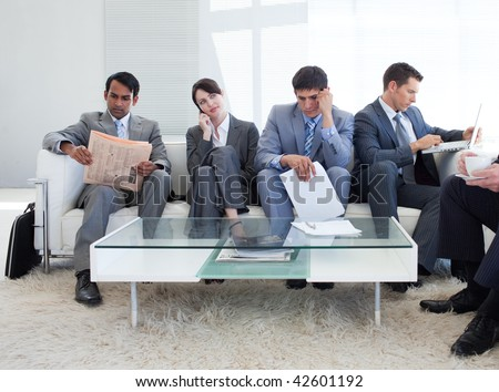 International business people sitting in a waiting room. Business concept.
