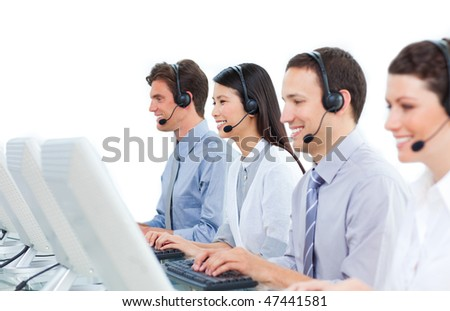 International business people talking on headset in a call center - stock photo