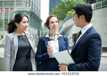 International business people talking to each other - stock photo