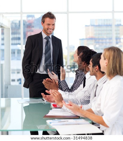 International business team applauding his colleague
