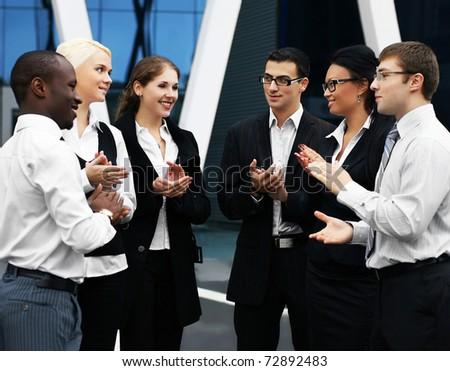 International business team over modern background - stock photo
