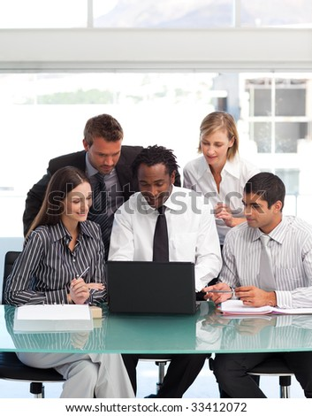 International business team using a laptop together