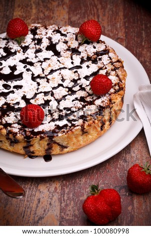International Cuisine - Desserts - Cheescake with chocolate decorated with strawberries. - stock photo