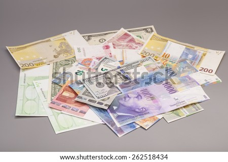 International currencies isolated on gray backgrond - stock photo