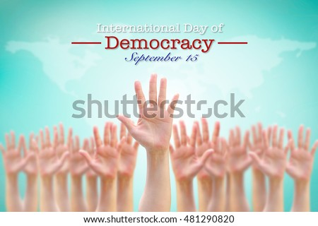 International day of democracy, September 15: UN observance to raise public awareness on importance of democratic rights society: Many human people hands raising up in air with world map background