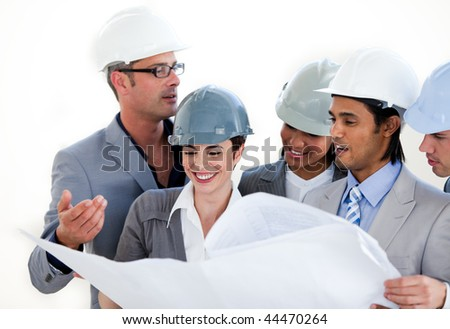 International engineers studying a construction plan against a white background - stock photo