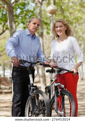 International family of active pensioners with bikes in sunny day