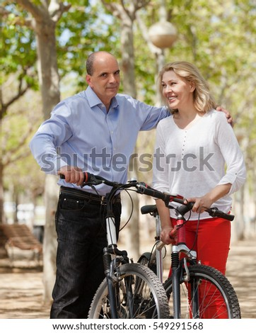 International family of active pensioners with bikes outdoor in sunny day