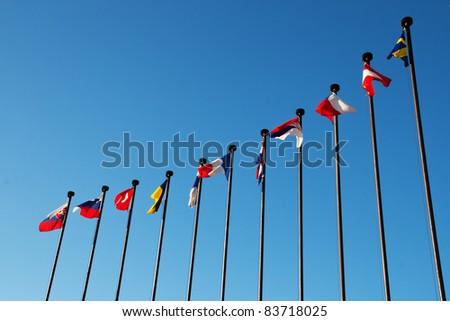 International Flags against blue sky - stock photo