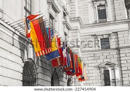 International flags at the Hofburg in Vienna, Austria  - stock photo