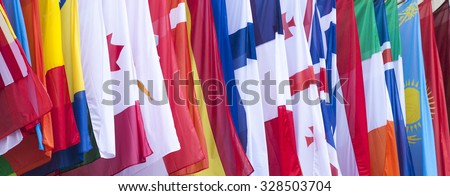 International Flags blowing in the wind - stock photo