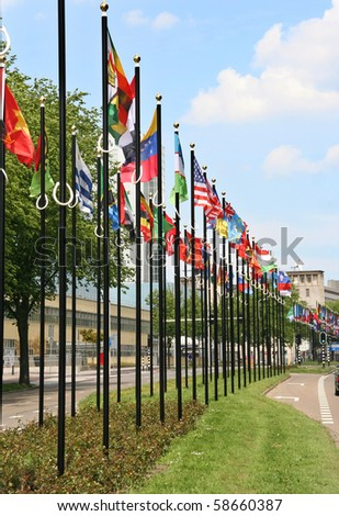 International flags next to UN buildings in The Hague, Holland - stock photo