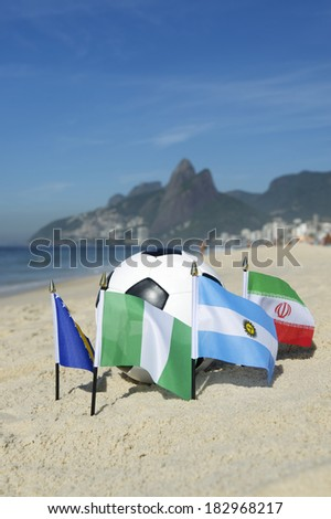International football country Group F team flags with soccer ball on Ipanema beach in Rio de Janeiro Brazil