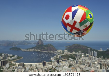 International football soccer ball above Rio de Janeiro skyline with Sugarloaf Pao de Acucar Mountain in the background Brazil - stock photo