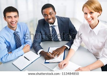 International group of business people working together. - stock photo