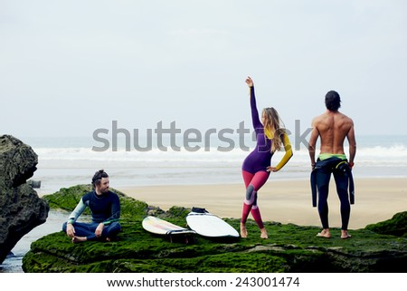 International group of friends having fun waiting big waves for surfing - stock photo