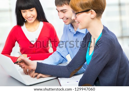 International group of young students studying together in a college - stock photo