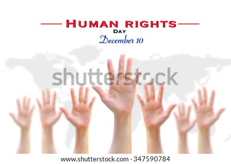International Human Rights Day: December 10th conceptual idea: Many people blur hands group raising upward on white background w/ world map showing participation in social, economic, politic areas   - stock photo