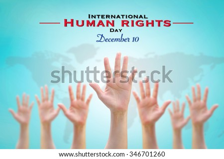 International Human Rights Day: December 10th conceptual idea: Many people blur hands raising up upward on vintage blue sky background w/ world map for participation in social economic politic areas