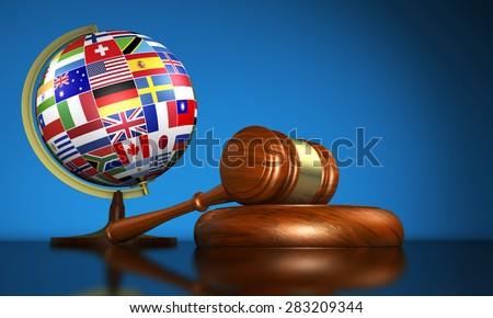 International law systems, justice, human rights and global business education concept with world flags on a school globe and a gavel on a desk on blue background. - stock photo