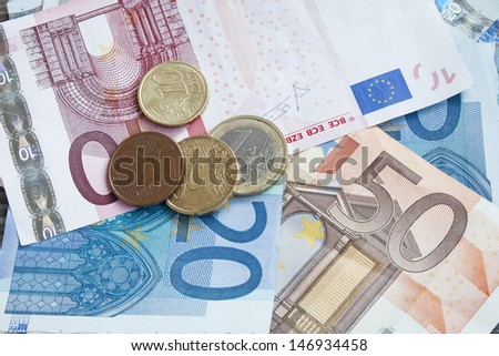 international money,financial concept,euro banknotes and coins