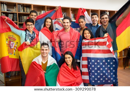 International multiethnic exchange of students, happy students presenting their countries with flags - stock photo