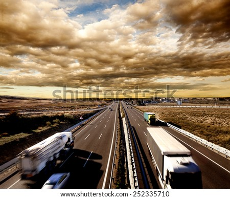 International shipment, trucks and cars driving on the highway. Logistics and warehousing - stock photo