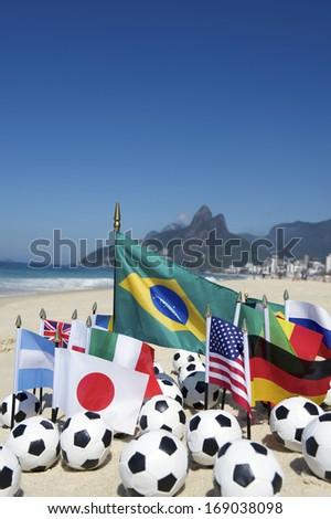 International soccer team flags with footballs on the beach in Rio de Janeiro Brazil - stock photo